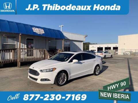 2014 Ford Fusion for sale at J P Thibodeaux Used Cars in New Iberia LA