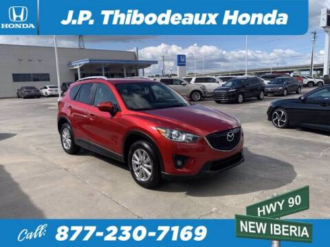 2015 Mazda CX-5 for sale at J P Thibodeaux Used Cars in New Iberia LA