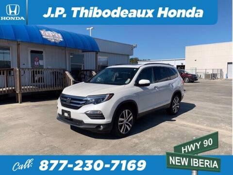 2017 Honda Pilot for sale at J P Thibodeaux Used Cars in New Iberia LA