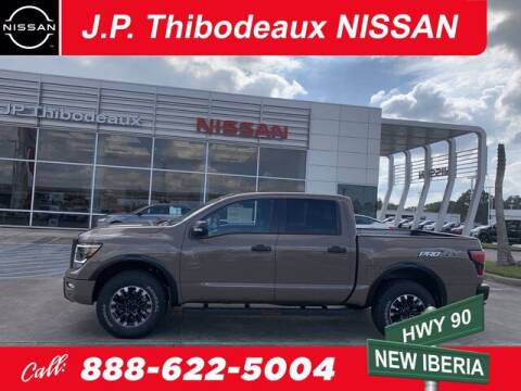 2021 Nissan Titan for sale at J P Thibodeaux Used Cars in New Iberia LA