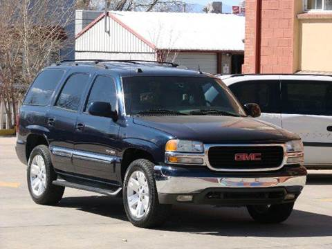 2004 GMC Yukon for sale at THE MANHATTAN AUTO GROUP in Greeley CO