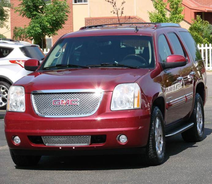 2007 GMC Yukon for sale at THE MANHATTAN AUTO GROUP in Greeley CO