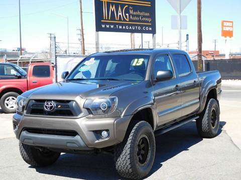 2013 Toyota Tacoma for sale at THE MANHATTAN AUTO GROUP in Greeley CO