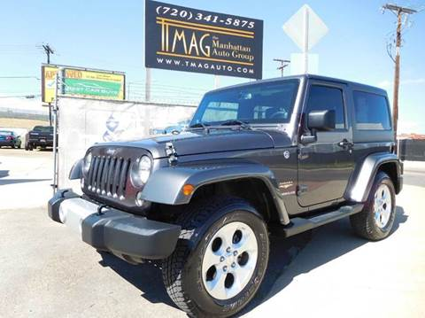 2014 Jeep Wrangler for sale at THE MANHATTAN AUTO GROUP in Greeley CO