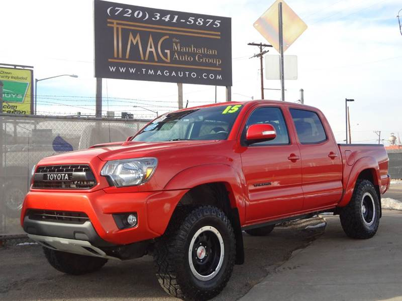 2015 Toyota Tacoma for sale at THE MANHATTAN AUTO GROUP in Greeley CO