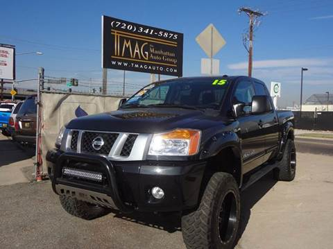 2015 Nissan Titan for sale at THE MANHATTAN AUTO GROUP in Greeley CO