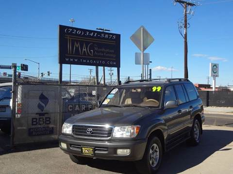 1999 Toyota Land Cruiser for sale at THE MANHATTAN AUTO GROUP in Greeley CO