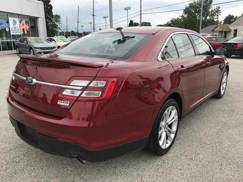 2014 Ford Taurus for sale at OLYMPIC MOTOR CO in Florissant MO