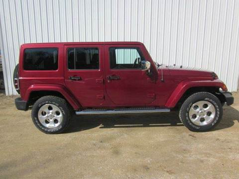 2013 Jeep Wrangler Unlimited for sale at SCHACHT MOTOR CO in Decorah IA