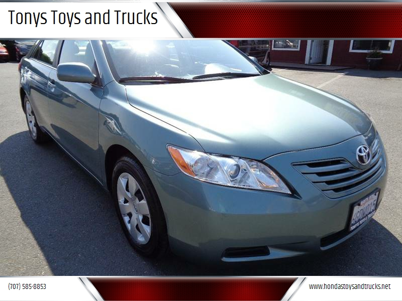 2009 TOYOTA CAMRY LE 4DR SEDAN 5A lt green one owner vehicle mirror color