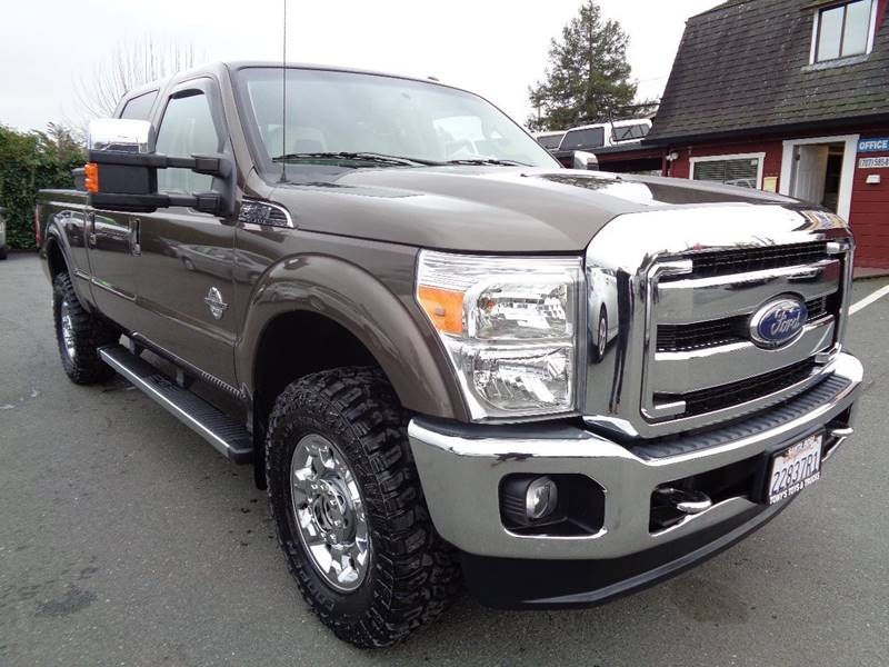 2015 FORD F-350 SUPER DUTY LARIAT 4X4 4DR CREW CAB 68 FT charcoal new tires  pickup bed l