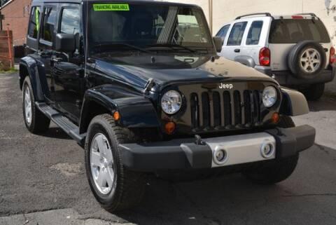 2012 Jeep Wrangler Unlimited for sale at CASTLE AUTO AUCTION INC. in Scranton PA