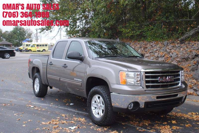 2013 GMC SIERRA 1500 SLE 4X4 4DR CREW CAB 58 FT SB tan bumper detail - rear step pickup bed li