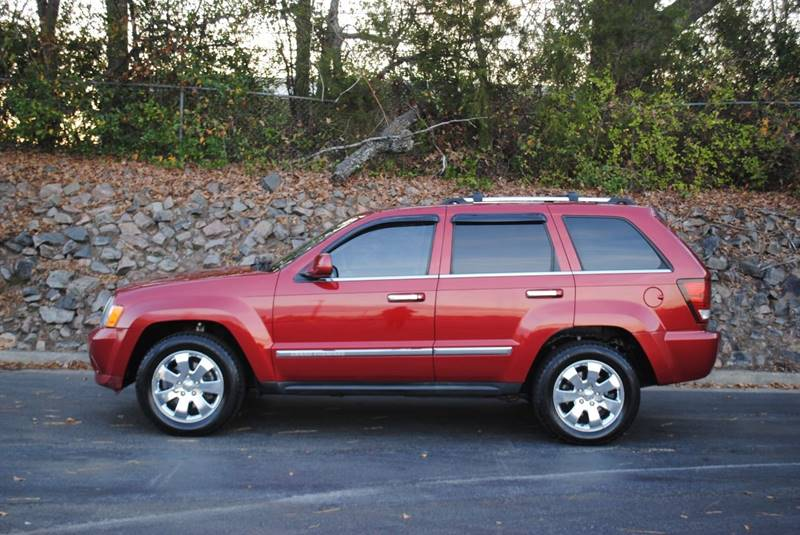 2010 JEEP GRAND CHEROKEE LIMITED 4X2 4DR SUV red body side moldings - chrome door handle color -