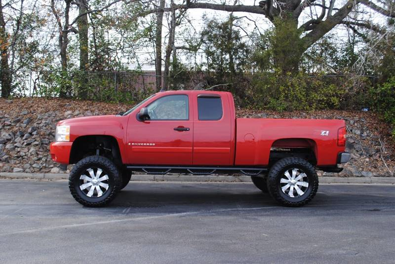 2007 CHEVROLET SILVERADO 1500 LT1 4DR EXTENDED CAB 4WD 58 FT red pickup bed light pickup bed t