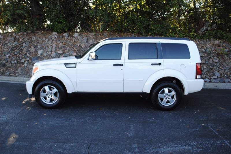 2009 DODGE NITRO SE 4X4 4DR SUV white body side moldings - body-color door handle color - black
