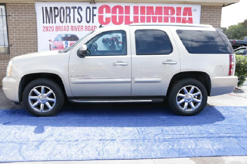 2007 GMC YUKON DENALI AWD 4DR SUV gold air conditioning power windows power locks power steeri