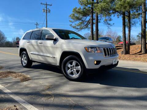 2011 Jeep Grand Cherokee for sale at THE AUTO FINDERS in Durham NC