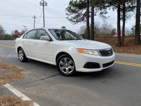 2009 Kia Optima for sale at THE AUTO FINDERS in Durham NC