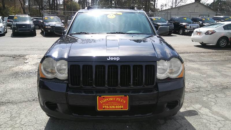 2010 JEEP GRAND CHEROKEE LAREDO 4X4 4DR SUV black 2-stage unlocking doors 4wd type - full time