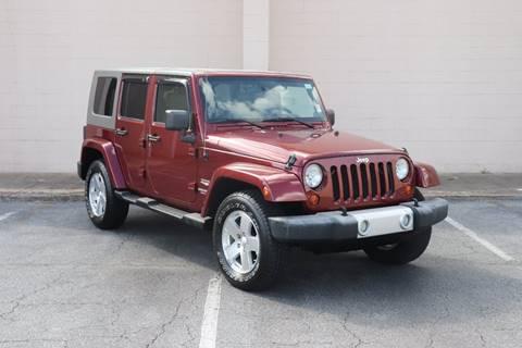 2009 Jeep Wrangler Unlimited for sale at El Compadre Trucks in Doraville GA