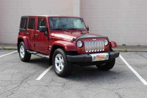 2013 Jeep Wrangler Unlimited for sale at El Compadre Trucks in Doraville GA