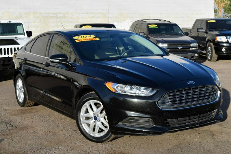 2014 FORD FUSION SE 4DR SEDAN black need a 4 door sedan if so this 2014 ford fusion is the match
