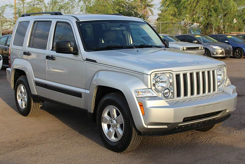 2012 JEEP LIBERTY SPORT 4X4 4DR SUV silver if youre in the market for a convenient compact 4x4 s