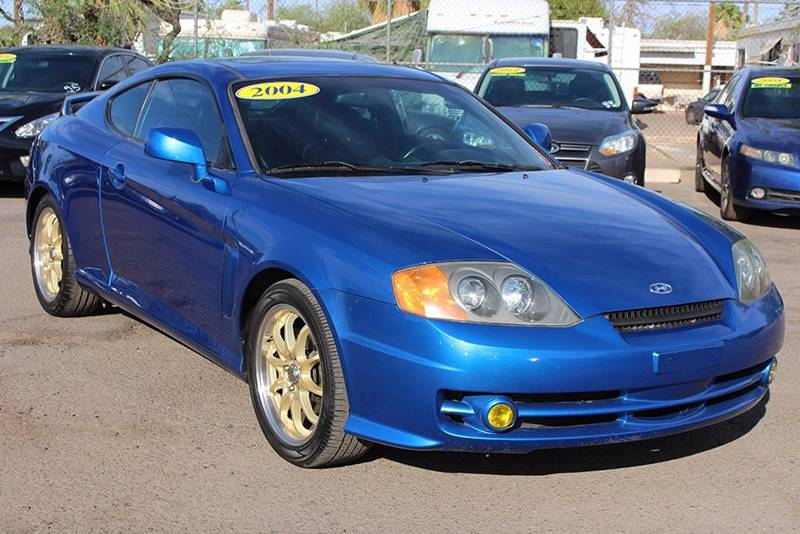 2004 HYUNDAI TIBURON GT V6 2DR HATCHBACK blue looking for a 6-speed manual 2 door coupe if so th