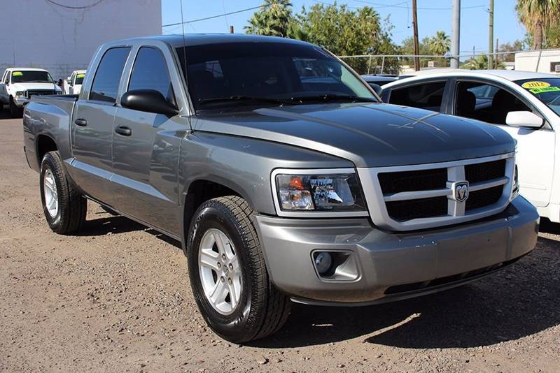 2011 RAM DAKOTA BIG HORN charcoal are you in need of a 4 door truck without the gas guzzling engi