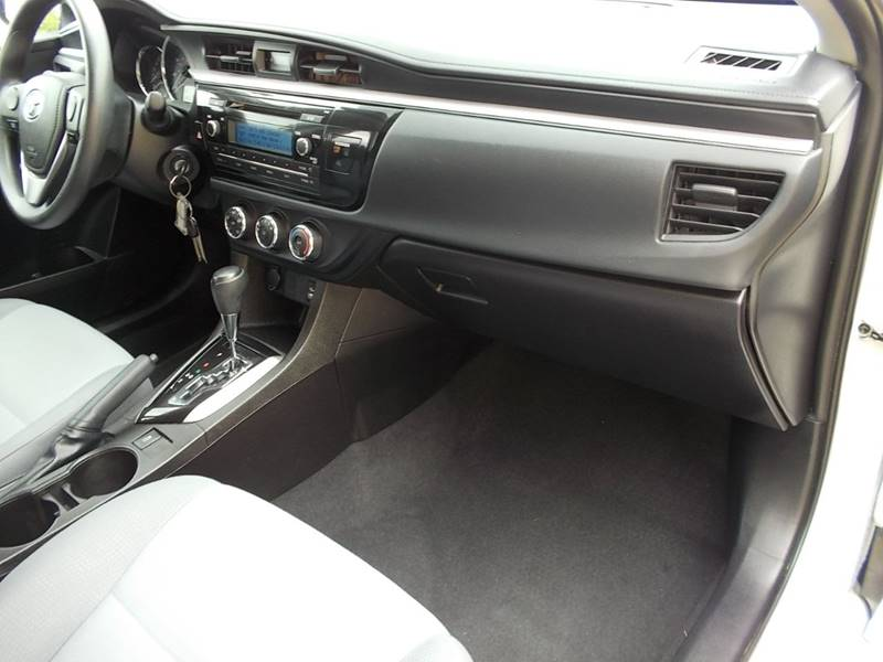 2014 Toyota Corolla for sale at Chimax Auto Sales in San Antonio TX