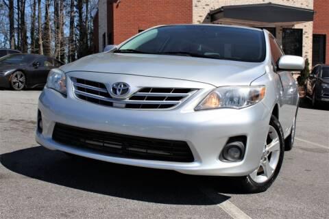 2013 Toyota Corolla for sale at Atlanta Unique Auto Sales in Norcross GA