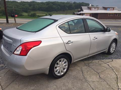 2012 Nissan Versa for sale at CESSNA MOTORS INC in Bedford PA