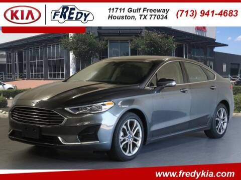 2019 Ford Fusion for sale at FREDY KIA USED CARS in Houston TX