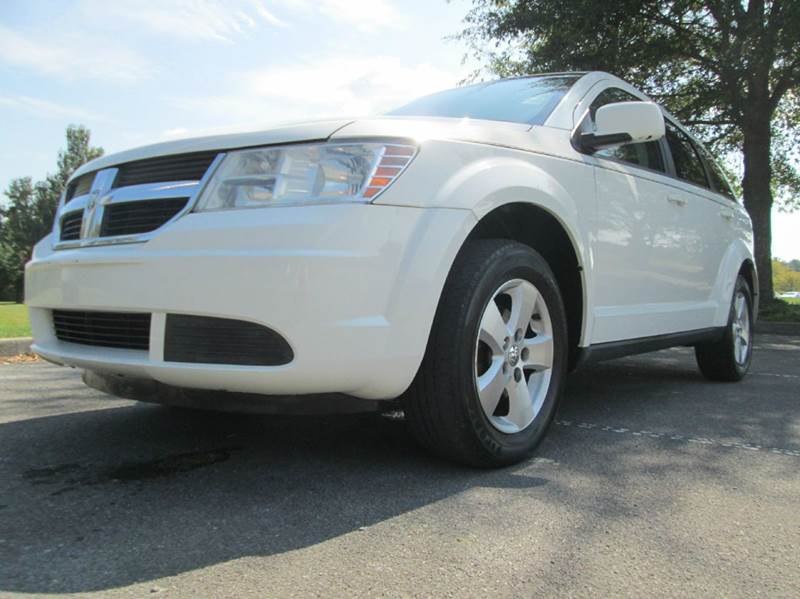 2009 DODGE JOURNEY SXT 4DR SUV white do you want a stylish vehicle that is still functional for y