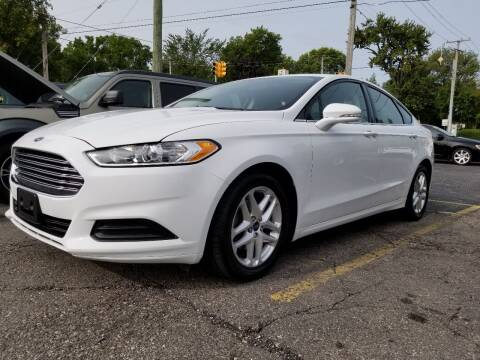 2016 Ford Fusion for sale at DALE'S AUTO INC in Mt Clemens MI