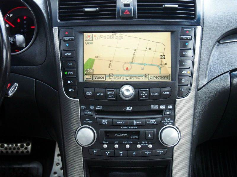 2007 acura tl navigation disc location