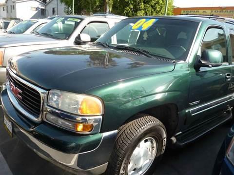 2004 GMC Yukon for sale at La Mesa Auto Sales in Huntington Park CA