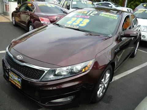 2012 Kia Optima for sale at La Mesa Auto Sales in Huntington Park CA