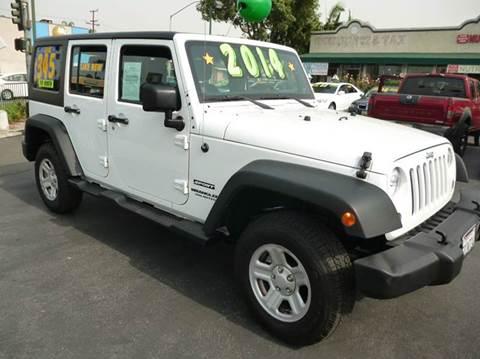 2014 Jeep Wrangler Unlimited for sale at La Mesa Auto Sales in Huntington Park CA