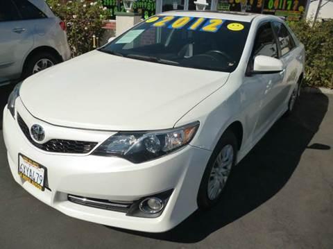 2012 Toyota Camry for sale at La Mesa Auto Sales in Huntington Park CA