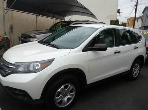 2014 Honda CR-V for sale at La Mesa Auto Sales in Huntington Park CA
