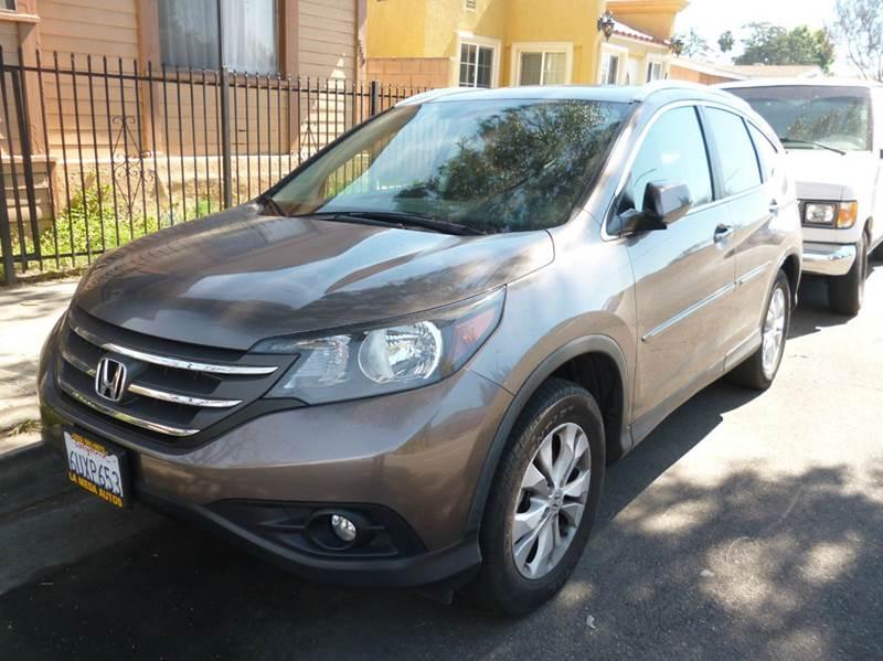 2012 Nissan Rogue for sale at La Mesa Auto Sales in Huntington Park CA
