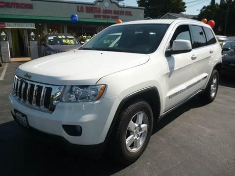 2011 Jeep Grand Cherokee for sale at La Mesa Auto Sales in Huntington Park CA