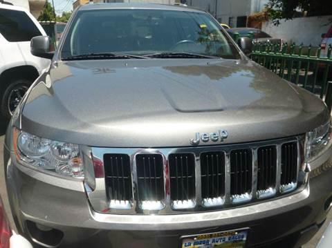 2012 Jeep Grand Cherokee for sale at La Mesa Auto Sales in Huntington Park CA