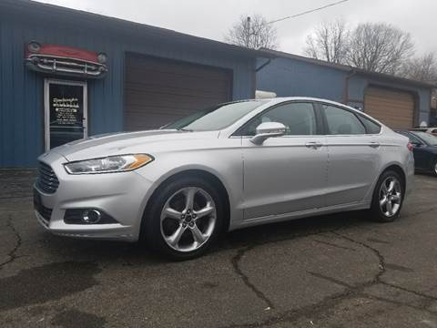 2016 Ford Fusion for sale at Rombaugh's Auto Sales in Battle Creek MI