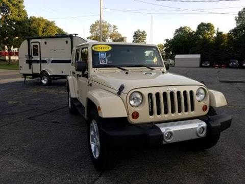 2011 Jeep Wrangler Unlimited for sale at Rombaugh's Auto Sales in Battle Creek MI