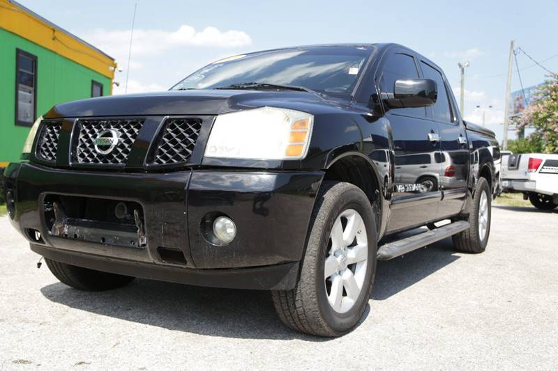 2006 NISSAN TITAN LE FFV 4DR CREW CAB SB black there are no electrical problems with this vehicle
