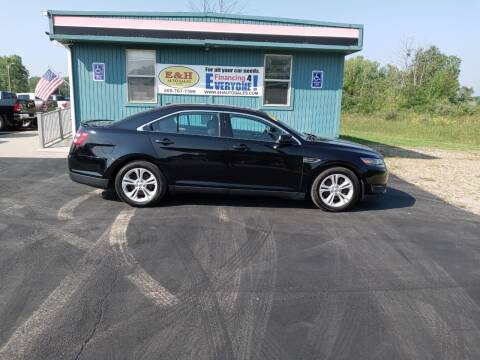 2016 Ford Taurus for sale at E & H Auto Sales in South Haven MI