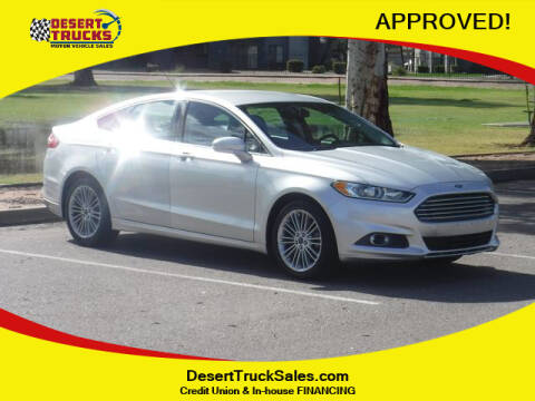 2013 Ford Fusion SE for sale at Desert Trucks in Phoenix AZ